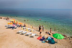 Prigradica - pláž za velkým molem